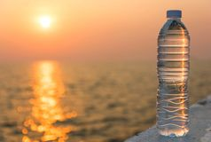 Plastic water bottle. With blue cap on sky background stock photos