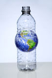 Plastic Water Bottle With Earth Inside Stock Image