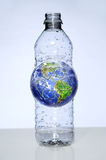 Plastic Water Bottle With Earth Inside Stock Photography