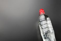 Plastic water bottle on grey background Stock Images