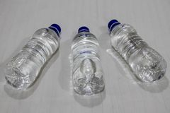 Water bottle lying on bed. Plastic water bottle lying on bed royalty free stock images