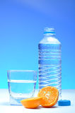Plastic water bottle and mandarin Royalty Free Stock Images