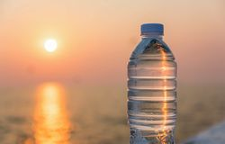 Plastic water bottle. With blue cap on sky background stock photo