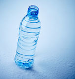 Plastic water bottle on wet background Royalty Free Stock Images