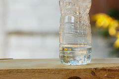 Plastic water bottle on wood Stock Image