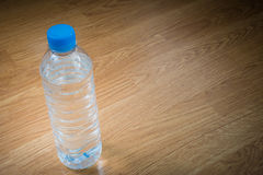 Plastic water bottle on the wooden table Stock Images