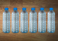 Plastic water bottle on the wooden table Royalty Free Stock Photos