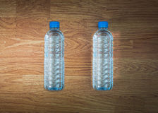 Plastic water bottle on the wooden table Stock Image
