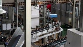 Plastic water bottles on conveyor or bottling machine stock video footage
