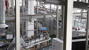 Plastic water bottles on conveyor or bottling machine stock video footage