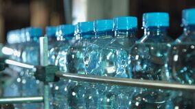 Plastic water bottles moving stock footage