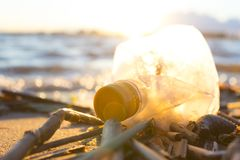 Plastic water bottles pollute ocean. Bottle on the cost stock images