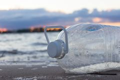 Plastic water bottles pollute ocean. Bottle on the cost stock photography
