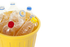 Plastic water bottles in trash bin Stock Images