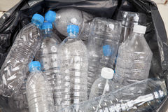 Plastic water bottles in the trash heap Royalty Free Stock Image