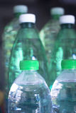Plastic water bottles in window light Royalty Free Stock Photo