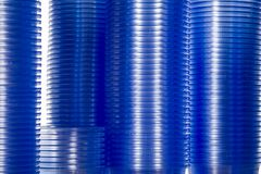 Plastic water cups for a vending machine. Stacks of water cups with blue colour, towers of cups Stock Photos