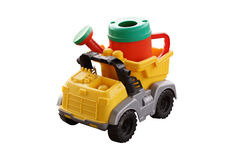 Plastic watering can in the back of a toy car. Royalty Free Stock Photo