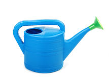 Plastic watering can isolated on a white Stock Photography