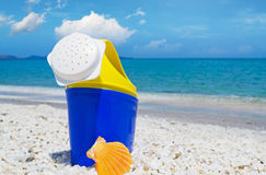 Plastic watering can by the sea Stock Photography