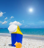 Plastic watering can by the sea Stock Image