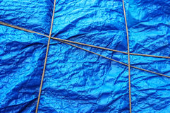 Plastic waterproof tarpaulin with rope. Texture of plastic waterproof tarpaulin with rope stock images