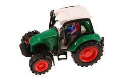 Plastic wheeled tractor toy. Wheeled tractor toy isolated on white Stock Photos