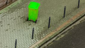 Plastic wheely bin in the street outside Royalty Free Stock Images