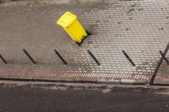 Plastic wheely bin in the street outside Royalty Free Stock Photo