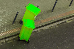 Plastic wheely bins in the street outside Stock Photos