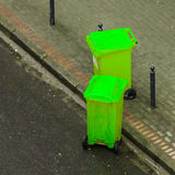 Plastic wheely bins in the street outside Stock Image