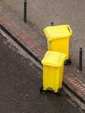 Plastic wheely bins in the street outside Royalty Free Stock Image