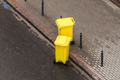Plastic wheely bins in the street outside Stock Photo