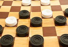 Plastic white and black checkers Royalty Free Stock Image
