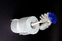 Plastic white blue toilet brush and paper Royalty Free Stock Images