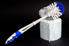 Plastic white blue toilet brush and paper Stock Photo