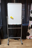 Plastic white flipchart stands in room interior, nobody Royalty Free Stock Photography