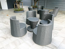 Plastic wicker chairs and table Stock Images