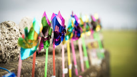 Plastic Windmills. Against a wall Royalty Free Stock Photos