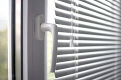 Plastic window with blinds stock image