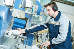 Plastic window and door manufacturing. Worker cutting PVC profile Royalty Free Stock Images