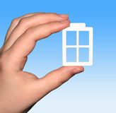 The Plastic window in hand. The Plastic window in hand on blue white background Stock Photography