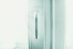Plastic window handle in shiny rays of light Royalty Free Stock Photo
