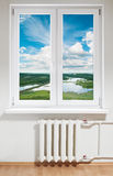 Plastic window and radiator Royalty Free Stock Photo