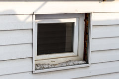 Plastic window in the siding. Plastic window in the wall of the unfinished siding Stock Photography