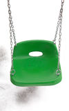 Plastic wing seat. New plastic green swing seat in against snow Royalty Free Stock Image