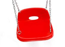 Plastic wing seat. New plastic red swing seat in against snow Stock Image