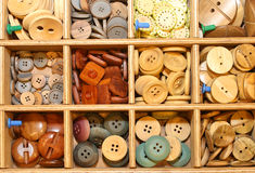 plastic and wooden buttons  in the shop Royalty Free Stock Photography