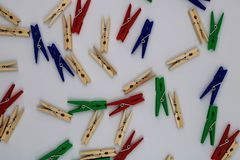 Plastic and wooden clothespins royalty free stock photos