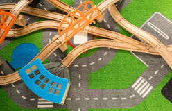 Plastic wooden track for train toy. On colorful carpet Stock Photos